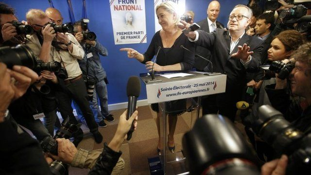 """Journalists surround Marine Le Pen, France""""s National Front political party head, who reacts to results after the polls closed in the European Parliament elections at the party""""s headquarters in Nanterre, near Paris"""