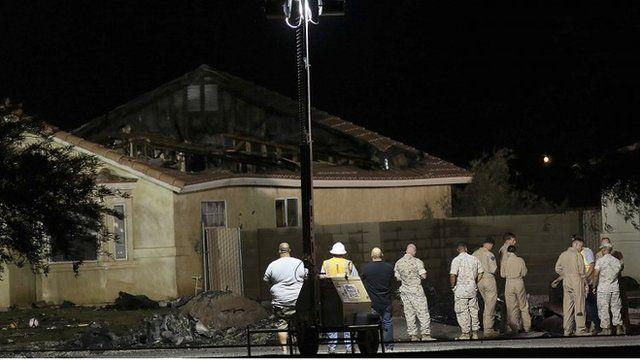 Investigators inspect the scene of a U.S. military jet crash in Imperial, California June 4, 2014