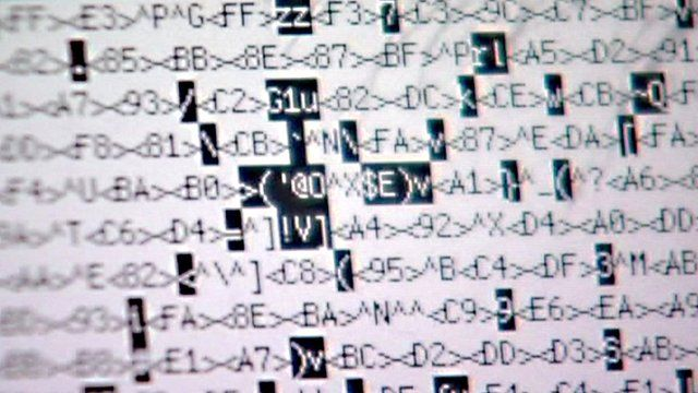 A computer display showing scrambled letters and numbers