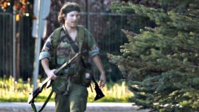 A heavily armed man that police have identified as Justin Bourque
