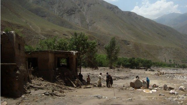 Afghan villagers search at the site after a flashflood landslide in the Guzargah-e-Nur district of Baghlan province on June 7, 2014