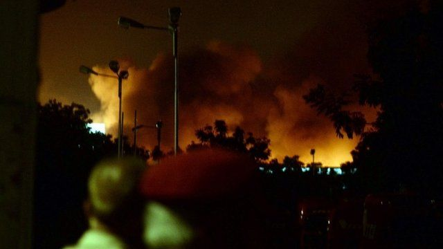 """Smoke rises from the Karachi airport terminal after the militants"""" assault in Karachi late on 8 June 2014"""