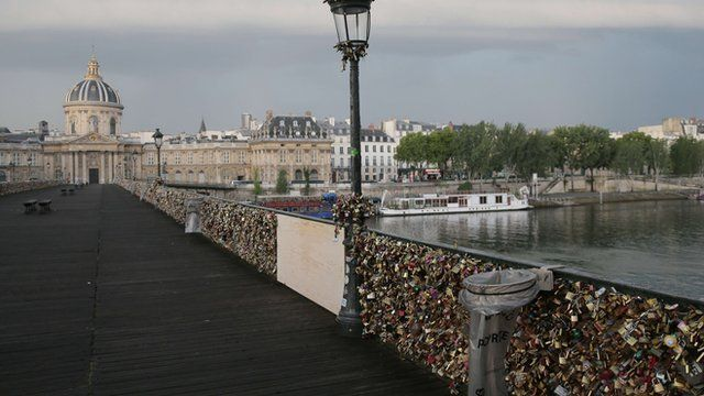 Part of Pont Des Arts footbridge in Paris boarded up.