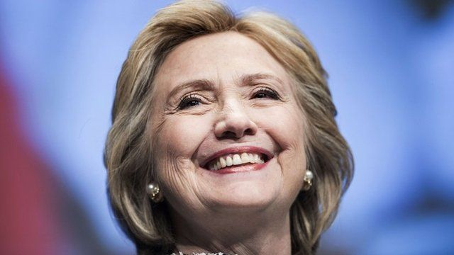 Former Secretary of State Hillary Clinton smiles before speaking at the World Bank in Washington