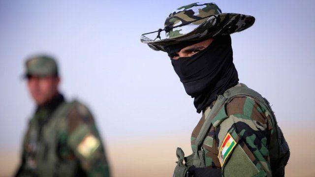 An Iraqi Kurdish security guard