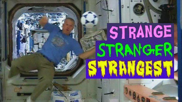 An astronaut heading a ball