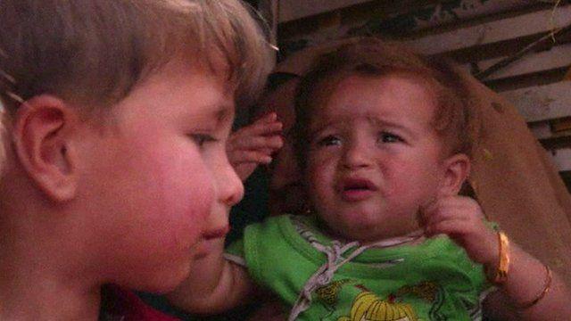 Displaced children fleeing Irbil, Iraq