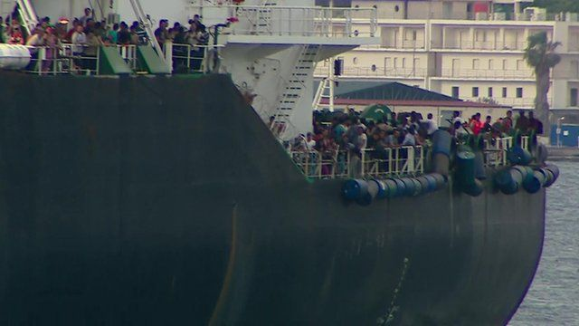 Migrants on board a ship