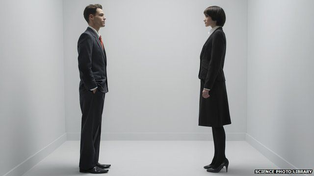 A man and woman standing up