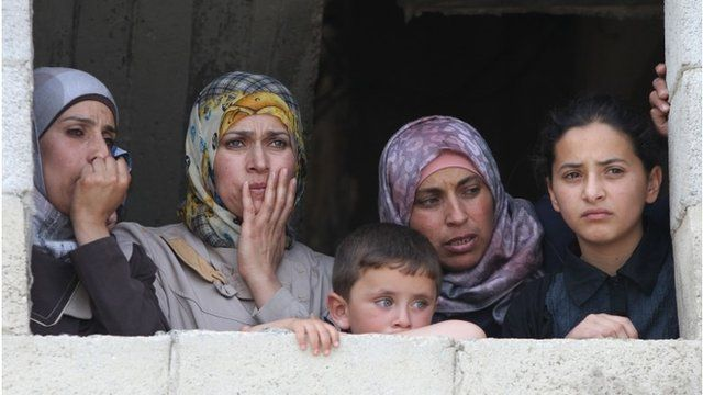 Relatives of Mohammed Dudin mourn during his funeral