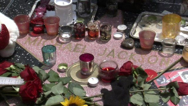 Michael Jackson star, covered in flowers and candles