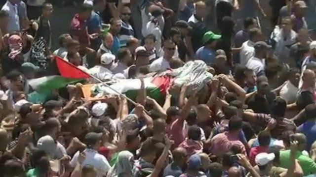 Mohammed Abu Khdair's body is carried through the streets