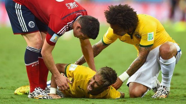 Neymar of Brazil lies on the field after a challenge
