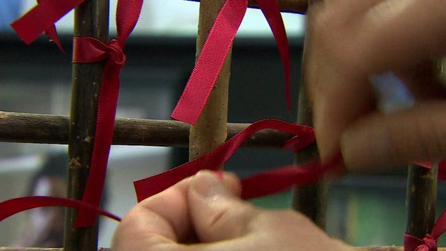 Red ribbons in memory of people who died