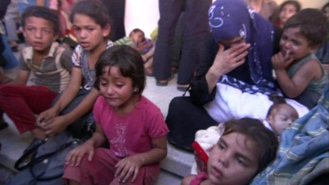 At least 13 people have been killed and more than 200 injured when a UN-run school used as a shelter in Gaza was shelled