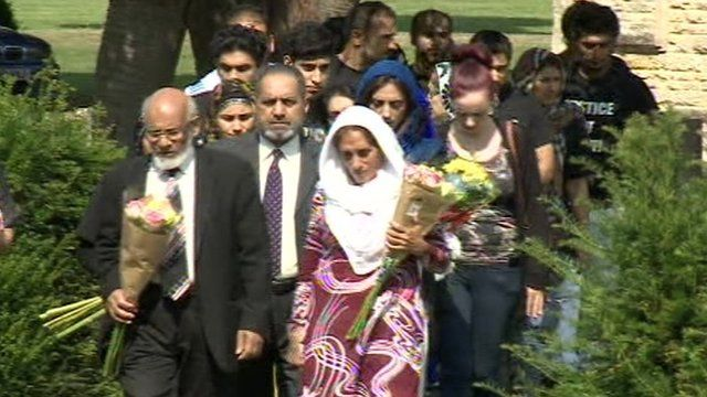 The Khan family visiting Majid and Anum's grave