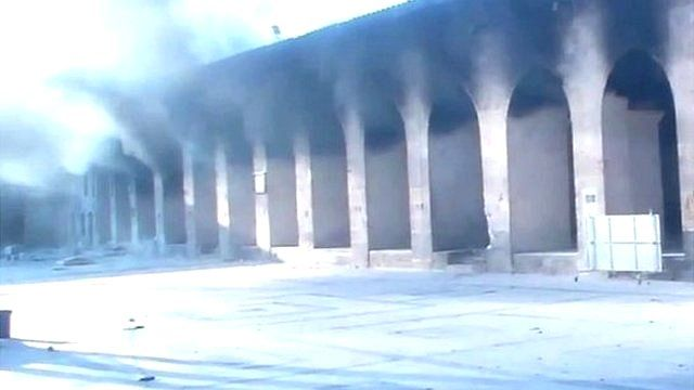 Smoke from arches of old building