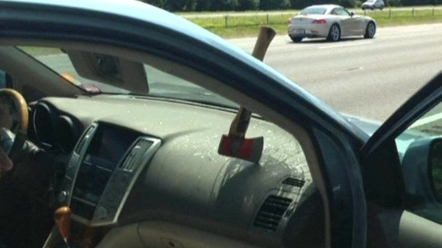 Axe through windscreen