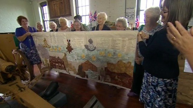 Women holding Hartlepool tapestry