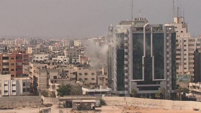 Gaza building is blasted by air strike
