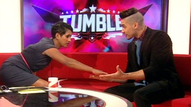 Naga Munchetty touches Louis Smith's hands