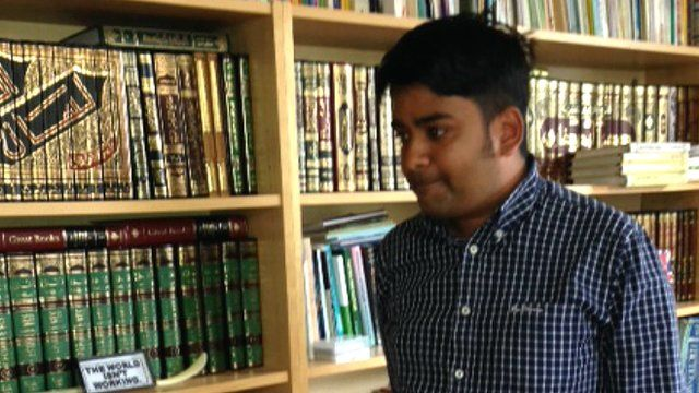 Hamja Ahsan in his family's library