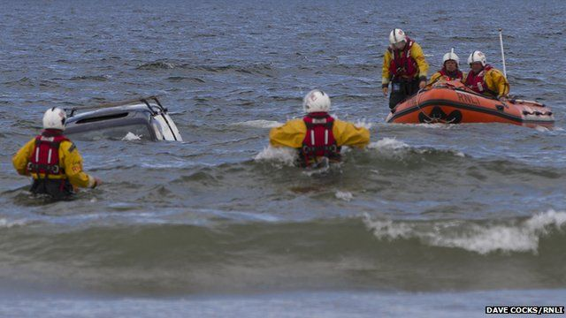 Car in sea with RNLI