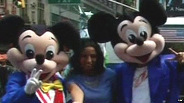 Woman with two Mickey Mouse performers in Times Square NYC