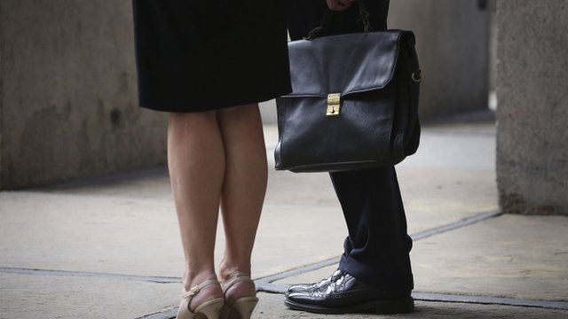 Woman and a man with briefcase