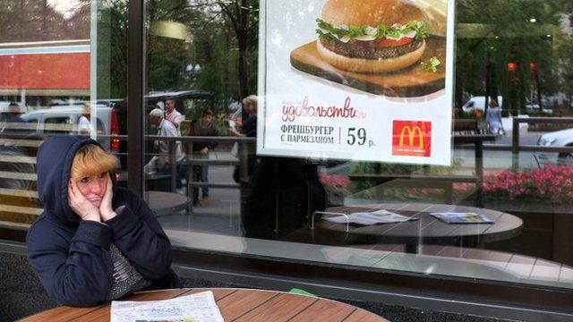 "A woman sits a table of a closed McDonald""s restaurant, the first to be opened in the Soviet Union in 1990, in Moscow on August 21, 2014"