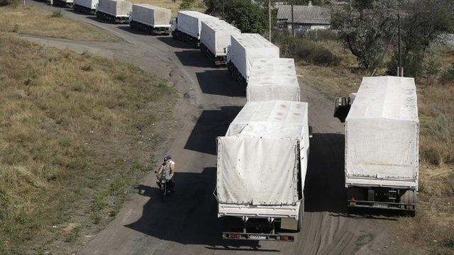 Trucks from the Russian aid convoy to Ukraine stand in line as they return to Russia