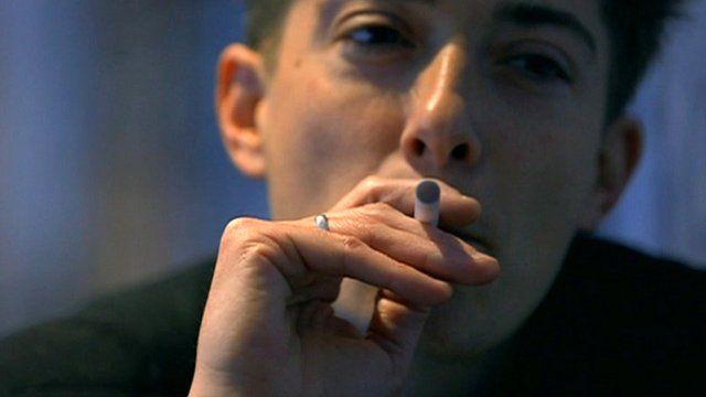 Man smoking e-cigarette