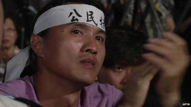 Protester with headband taking part in pro-democracy demonstration in Hong Kong