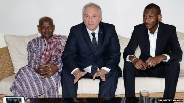"Lassana Bathily""s father, France's ambassador to Mali, Gilles Huberson, and Lassana Bathily"