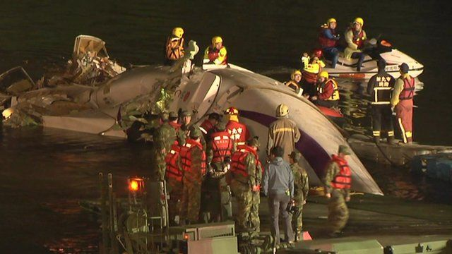 Rescue workers try to free passengers from the plane