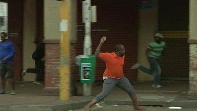 A man throwing a rock