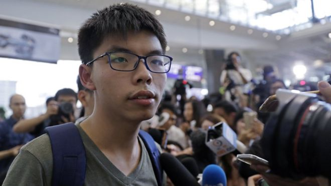 Joshua Wong speaks to media on arrival back in Hong Kong on 5 October 2016