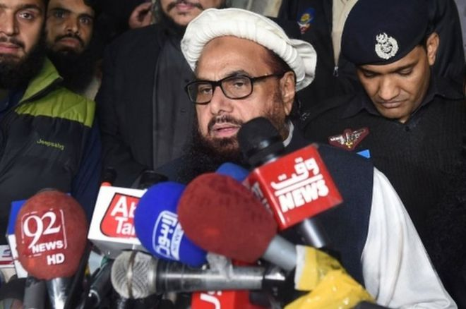 Hafiz Saeed speaks to the press after being detained by police in Lahore, early on January 31, 2017.