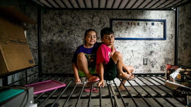 "Aiden and his little sister, Jubilee, sit on what's left of their bunk beds in the Baton Rouge home that was new to them just months ago. Their mother, Mimi, said: ""Today we're going to call it an early day so that Aiden can celebrate his birthday, because not even this flood should get in the way of that."""