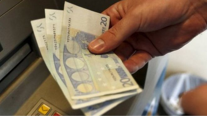 Greek man withdraws money