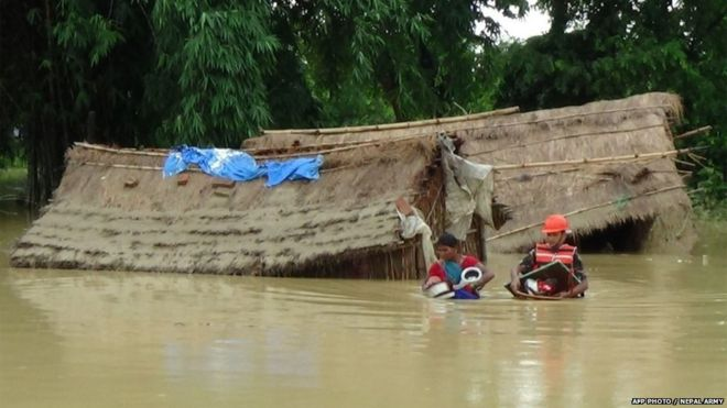 Nepalese army personnel rescue flood victims at Nawalparasi, around 200 km west of Kathmandu on July 26th