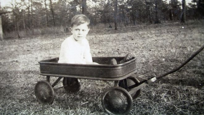 Donald Grey Triplett in a field, as a boy