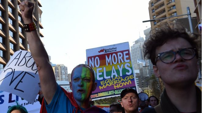 Same-sex marriage supporters march through the streets of the central Sydney