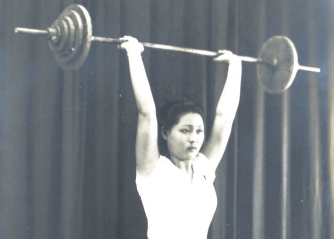 Madam Ho lifts weights during an earlier training session