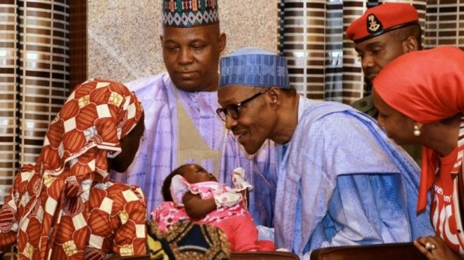 Amina Ali Nkeki with her child, meeting President Buhari