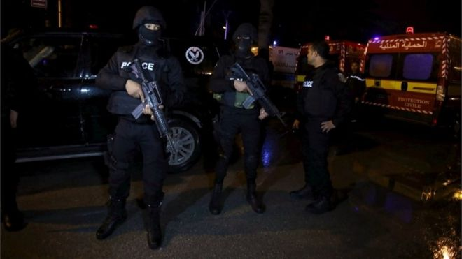 Tunisian police officers are pictured after an attack on a military bus in Tunis, Tunisia November 24, 2015