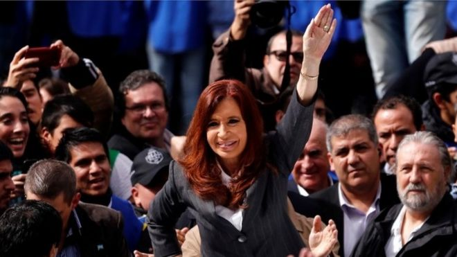 Cristina Fernandez leaves a court building in Buenos Aires, Monday, April 13, 2016