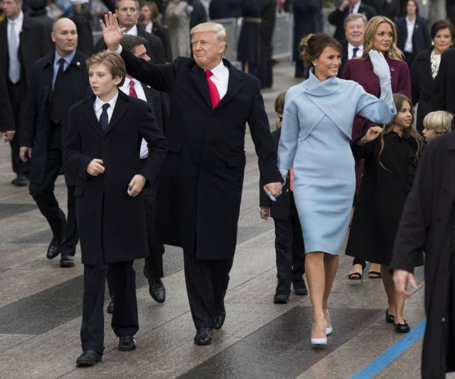 US President Donald Trump (centre) with his wife Melania (right) and son Barron (left) during the inauguration parade in Washington. Photo: 20 January 2017