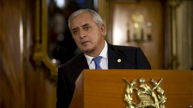 Guatemala's President Otto Perez Molina looks out from behind a podium during his press conference in Guatemala City on 31 August, 2015
