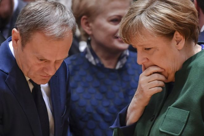 German Chancellor Angela Merkel, right, speaks to European Council President Donald Tusk, left, and Lithuanian President Dalia Grybauskaite, centre, during a round-table meeting at an EU summit in Brussels on Friday, 10 March